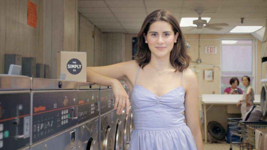 Lauren with The Simply Co. detergent at a laundromat