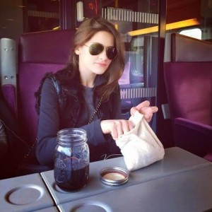 Lauren Singer enjoying a meal on a train in Europe with reusable containers, dishware and utensils.