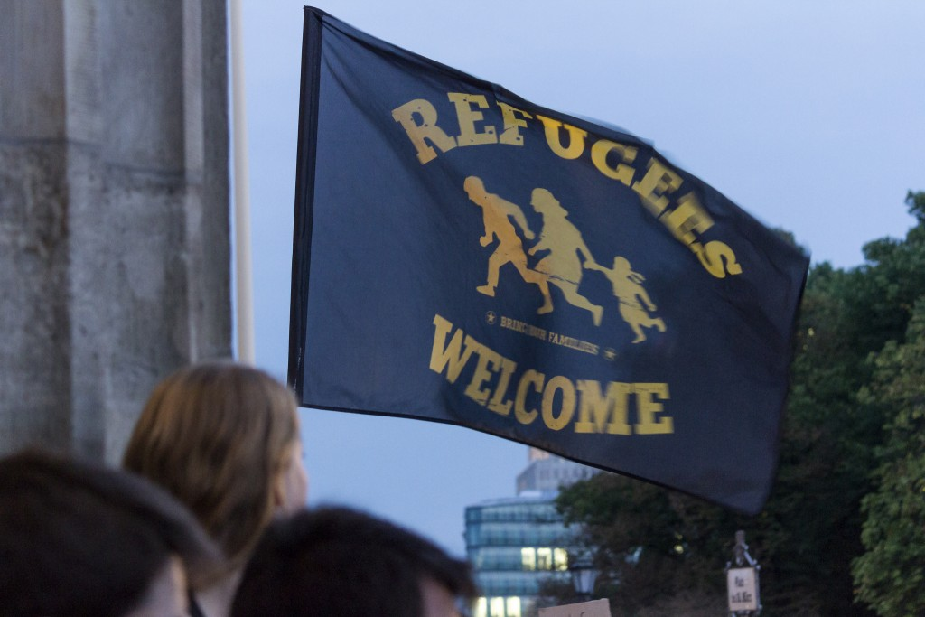 A Refugees Welcome flag flies in Berlin | Photo Courtesy of Leif Hinrichsen